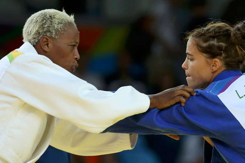 Refugee Olympic Team's Yolande Mabika, left, and Linda Bolder of Israel compete in judo during the Summer Olympics in Rio de Janeiro Aug. 10.