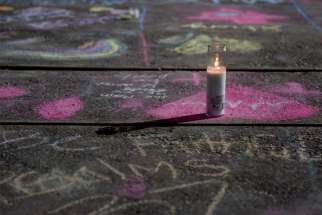 Messages written in sidewalk chalk are seen at the University of Texas of the Permian Basinas Sept. 2, 2019, following an Aug. 31mass shooting in Odessa, Texas.