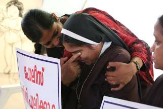 A woman religious is consoled during a Sept. 13 protest in Cochin, India, demanding justice after a nun accused Bishop Franco Bishop Franco Mulakkal of Jalandhar of raping her.