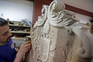 Bosnian woodcarver-sculptor Edin Hajderovac works on a chair for Pope Francis at his workshop in Zavidovici, Bosnia- Herzegovina, May 25. He and his father, Salem Hajderovac, are putting the finishing touches to the chair made from walnut trees, which Po pe Francis will use during his visit to Sarajevo. The father and son, both devoted Muslims, initiated the project in the belief that it will reflect the message of peace that the Catholic Church's top leader will bring to Bosnia.