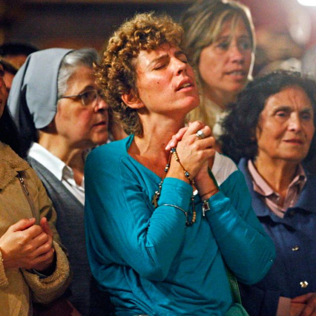 Women react at Metropolitan Cathedral in Buenos Aires, Argentina, March 13 after the election of new pope. The world's cardinals, meeting in conclave at the Vatican, elected as pope Cardinal Jorge Mario Bergoglio of Buenos Aires, who took the name Franci s. The 76-year-old Jesuit is the first Latin American pope.