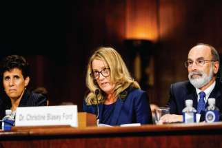 Christine Blasey Ford, with lawyer Debra S. Katz, left, answers questions at a Senate Judiciary Committee hearing in Washington. Ford testified about an accusation that Supreme Court nominee Judge Brett Kavanaugh sexually assaulted her in 1982.