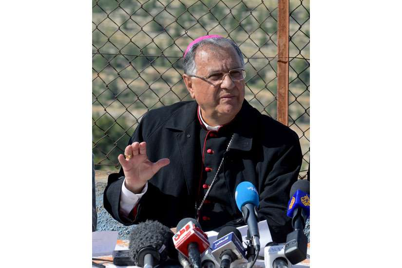 Latin Patriarch Fouad Twal of Jerusalem called for an end to the violence in Syria, saying that the refugees have lost hope in returning back home. In this photo, Twal speaks at a news conference at a convent in Cremisan Valley in Beit Jala, West Bank, April 2.