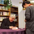 Toronto's Cardinal Thomas Collins signs a copy of his new book, Cornerstones of Faith, at the archdiocese's pastoral centre Feb. 20.
