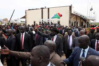 South Sudan President Salva Kiir is welcomed by supporters on his return from peace talks in Kampala July 9 at the Juba Airport. As South Sudanese peace negotiations tackled the last outstanding issues, church leaders called for genuine dialogue, healing and trust building, so that politicians have the will to implement a peace pact.