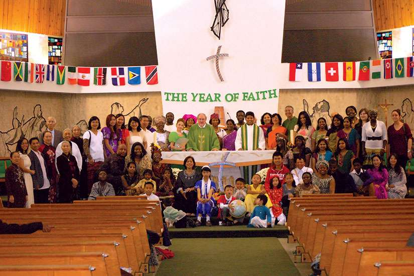 Fr. Massey Lombardi with a few children clad in the traditional garments of their heritage following the Mass that kicked off the Year of Faith at Toronto's St. Wilfrid's parish in 2012.