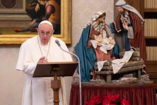 Pope Francis leads the Angelus prayer from the library of the Apostolic Palace at the Vatican Jan. 10, 2021. Always celebrate the date of one's baptism, which reflects God's never-ending love, the pope said.