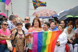 A crowd gathers for a massive same-sex wedding in San Juan, Puerto Rico, Aug. 16. Sixty-four of the 73 same-sex couples scheduled to take vows attended the event, the day a severe months-long drought broke with heavy rain throughout the island.