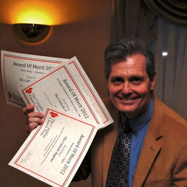 Associate Editor Michael Swan with the three first-place prizes he received at the annual Canadian Church Press Awards of Merit.