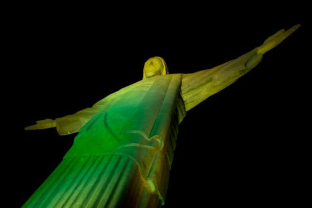 Rio's Christ the Redeemer Statue glows green to help kickoff the 2014 FIFA World Cup.
