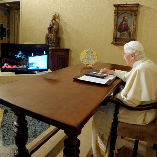 Pope Benedict XVI lights up one of the world's largest electronic Christmas trees in Gubbio, Italy, using an electronic tablet at the Vatican Dec. 7.