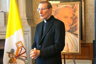 Papal nuncio,Archbishop Luigi Bonazzi invokes the intercession of St. John Paul II as he gave a blessing to the Parliament Hill gathering marking the first Pope John Paul II Day.