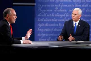 U.S. Sen. Tim Kaine of Virginia, the Democratic nominee for vice president, and Indiana Gov. Mike Pence, the Republican nominee, speak during their vice presidential debate Oct. 4 at Longwood University in Farmville, Va.