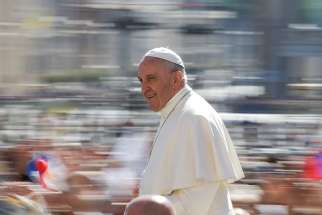 Pope Francis arrives for his general audience in St. Peter's Square May 17 at the Vatican.