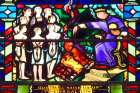 The Martyrdom of the Maccabees stained glass window from St. Etheldreda's Catholic Church, London, UK.