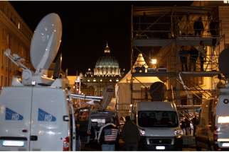 Satellite trucks and a riser for television journalists are seen at the foot of Via della Conciliazione, the road leading to the Vatican. Almost everything we do depends on something in space and Project Ploughshares says it will continue to be on the frontlines in the fight against the weaponization of space.