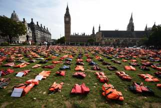 Life jackets worn by fleeing refugees lie in Parliament Square in London, U.K. Sept. 19. The number of migrants and refugees who have died at sea is expected to reach an all-time high in 2016, according to the U.N. Refugee Agency.