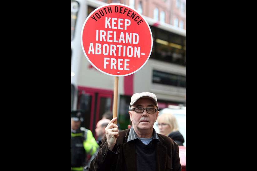 "A pro-life supporter demonstrates in 2012 outside the Marie Stopes clinic in Belfast, Northern Ireland. The Catholic bishops of Northern Ireland have described as ""profoundly disquieting"" a ruling by the High Court that the region's ban on abortion in all but very limited circumstances breaches human rights legislation."