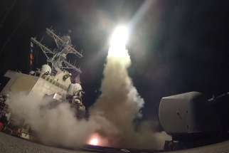 The USS Porter, in the Mediterranean Sea, fires a Tomahawk missile April 7. The missile strike on a Syrian air base days after chemical weapons were dropped on civilians in rebel-controlled territory further endangers innocent people, said observers familiar with the just-war theory.