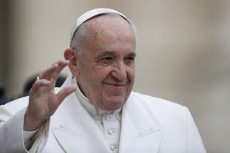 Pope Francis waves as he arrives for his general audience in St. Peter's Square at the Vatican Feb. 22.