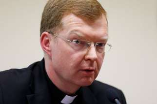 Jesuit Father Hans Zollner, a psychologist and academic vice rector at the Pontifical Gregorian University in Rome, attends a news conference at the university in this Feb. 16, 2015, file photo.