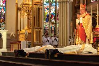 Cardinal Thomas Collins presides at 2018 ordination Mass at St. Michael's Cathedral in Toronto.