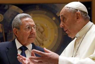 Pope Francis talks with Cuban President Raul Castro during a private audience at the Vatican May 10.