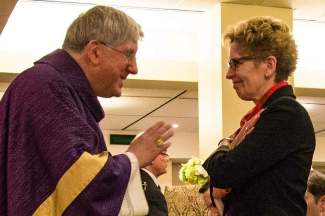 Toronto's Cardinal Thomas Collins blesses Ontario Premier Kathleen Wynne at the first-ever Roman Catholic Mass celebrated at Queen's Park in Toronto.