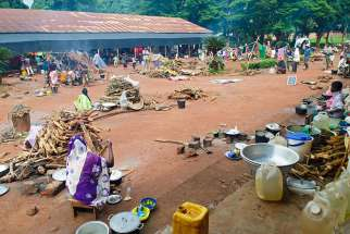 Displaced people are seen on the grounds of a seminary Aug. 9 in Bangassou, Central African Republic. Catholic priests whose villages have been attacked have taken to Facebook to express outrage and appeal for help.