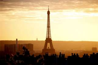 The Eiffel Tower is seen at sunset in Paris Nov. 22. Catholic organizations said the terror attacks in Paris had not dissuaded them from attending the UN climate change conference Nov. 30-Dec. 11.