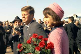 U.S. President John F. Kennedy and first lady, Jacqueline Kennedy, arrive at Love Field in Dallas Nov. 22, 1963.
