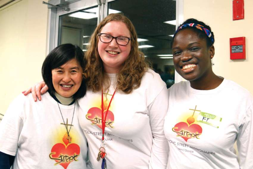One Challenge foundress Mildred Moy, left, with street missionaries Fredrickson and Fehintola Okunubi. Teresa Do (not pictured) has also joined the full-time initiative.