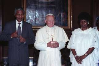 St. John Paul II poses with Nelson Mandela and his wife, Winnie Madikizela-Mandela, in 1990 at the Vatican. The April 14 funeral service for Madikizela-Mandela, who died April 2 at age 81, was attended by tens of thousands of people and was followed by a burial ceremony at a memorial park north of Johannesburg.
