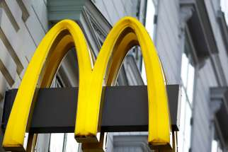 The logo of McDonald's is seen outside a shop in Vienna in Vienna on Oct. 1, 2016.