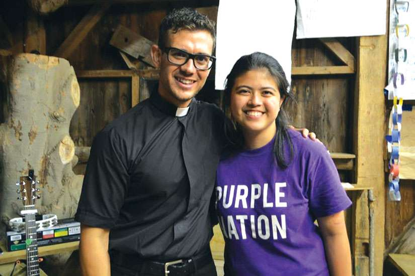 Camp counsellor Sophia Mutuc poses for a photo with priest and singer-songwriter Fr. Rob Galea.