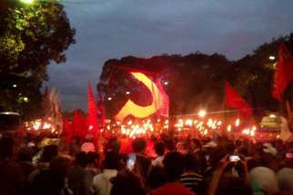 On the day he was killed, Paez had facilitated the release of an organizer of a farmers' group arrested by the army in March. Torches and the golden sickle are said to symbolize the productive force of the Philippine society, according to the protesting group.