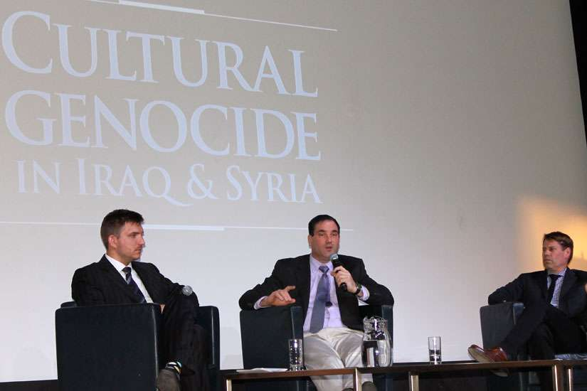 From left, Sascha Priewe, Clemens Reichel and Patrick Graham take part in a panel discussion on the cultural genocide taking place at the hands of the Islamic State in Iraq and Syria. The discussion took place April 14 at the Royal Ontario Museum in Toronto.