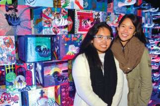 Toronto Catholic students Angela Gavin and Leslie Visaya, from Cardinal Carter Academy for the Arts and Loretto College School respectively, spent Nuit Blanche helping to express a message of charity though art.