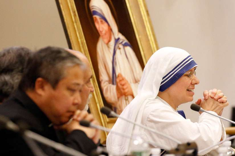 Sister Clare Roy, a member of the Missionaries of Charity, closes her eyes and clasps her hands as she speaks during a conference at the United Nations Sept. 9 on St. Teresa of Calcutta's enduring message to the international community.