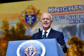 Carl Anderson, CEO of the Knights of Columbus, smiles as he addresses attendees Aug. 6 at the 137th annual Knights convention in Minneapolis.