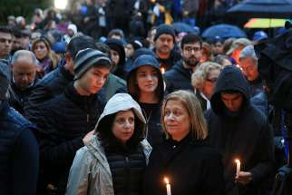 People mourn the loss of life as they hold a vigil for the victims of the Tree of Life Synagogue shooting in Pittsburgh Oct. 27. Pope Francis at his Sunday Angelus prayed for those affected by the attack inside the Pittsburgh synagogue.
