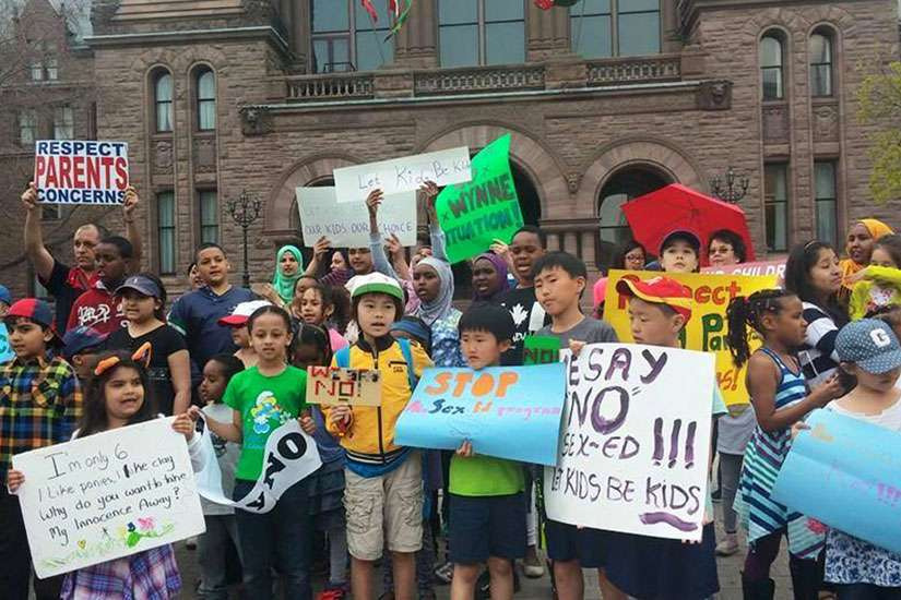 Some of the thousands of students who were pulled from class by their parents May 4 join a protest outside Queen's Park against the province's new sex-ed curriculum.