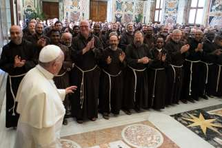 Pope Francis meets Sept. 14 at the Vatican with members of the Capuchin general chapter. During the chapter meeting, the Capuchins elected Italian Father Roberto Genuin as their new minister general.