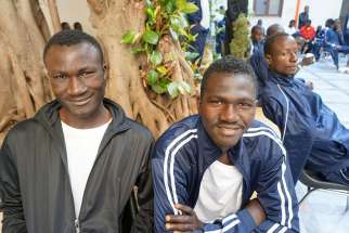 African migrants gather at the Caritas diocesan center in Palmero, Sicily, June 1.