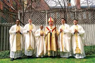 Following the May 10 ordination ceremony Fr. Neiman D'Souza, Fr. Scott Birchall, Fr. Michael Simoes, Cardinal Thomas Collins, Fr. Marijan Šiško and Fr. Omar Hernandez gather in the rectory's backyard.
