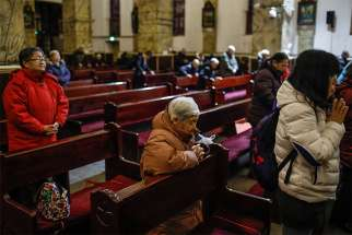 Chinese Catholics pray in late January in the Cathedral of the Immaculate Conception in Beijing.