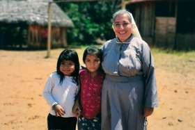Sr. Rosa Elena Pico, a member of the Missionaries of Mary Co-Redemptrix, poses with children from the Indigenous community of Sarayaku, Ecuador. Pico has worked in the community since 2017 and occasionally leads the liturgy of the word in the absence of a priest.