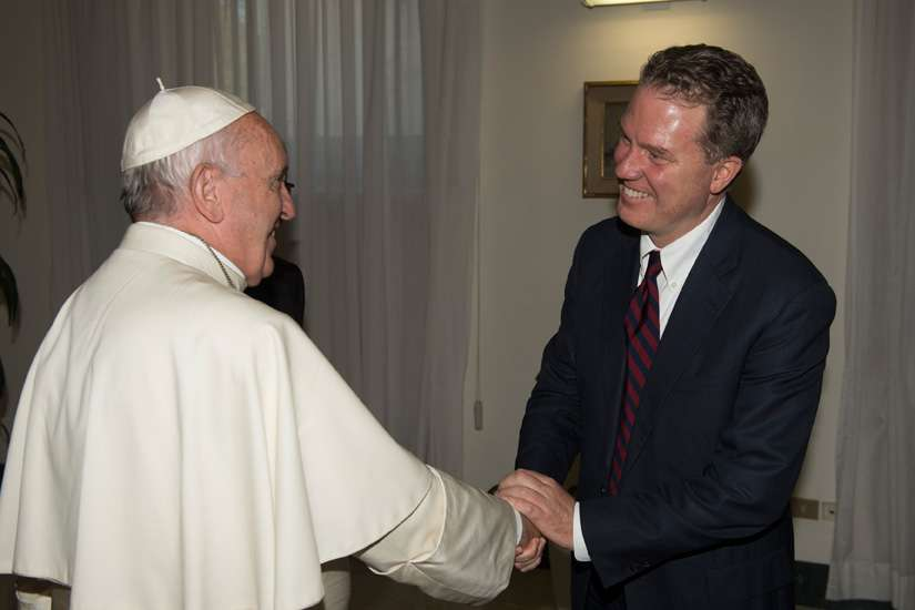 Pope Francis greets Greg Burke, the new director of the Vatican press office, at the Vatican July 11. Burke, a native of St. Louis, has worked for the Vatican since 2012 and prior to that was a television correspondent for Fox News and a correspondent for Time magazine.