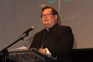 "Cardinal Gerald Lacroix of Quebec, seen here at Salt + Light's 15th anniversary celebration May 25, said it is a ""big mistake"" for women to embrace feminism at the Ontario Catholic Women's League convention July 10."