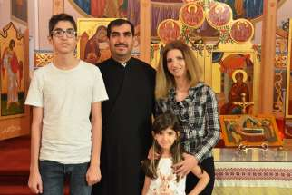 Fr. Issa Maamar and his family —  wife Rima Chahin and children Jean Pierre, 14, and Anna Marie, 6 — were forced to flee Syria in 2016 and have settled in Edmonton where Maamar leads the Greek-Melkite Church.